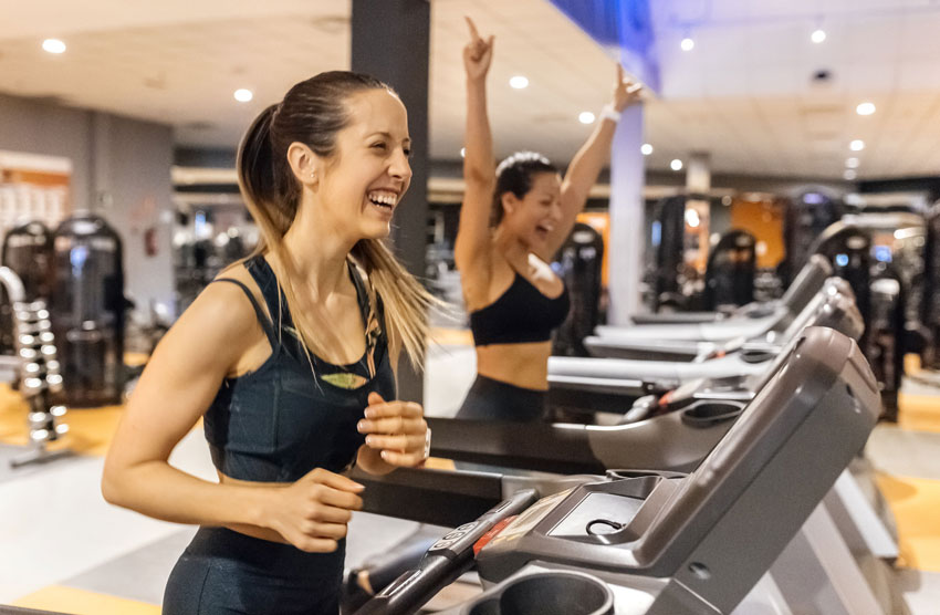 two-happy-women-working-out-in-gym